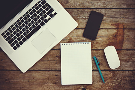 Workplace business still life. blank empty notebook, laptop, tablet pc, mobile phone, pen Stock Photo