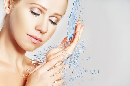 nude wet: Beauty woman skin care, washing with splashes and drops of water