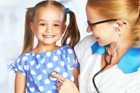 girl care: Doctor pediatrician and child patient at the reception Stock Photo