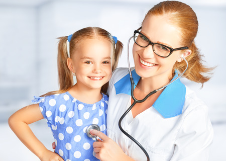 happy nurse: Doctor pediatrician and child patient at the reception Stock Photo
