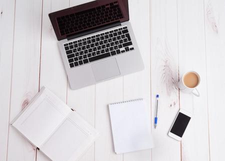 Workplace business still life. laptop, coffee, pen notebook