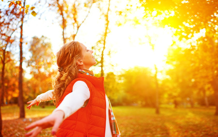 woman relax: happy girl enjoying life and freedom in the autumn on the nature