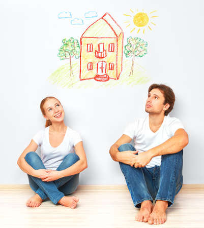 dream house: Concept: The housing and mortgage for young families. couple dreaming of his home