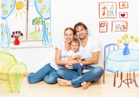 개념 가족 : 새 아파트의 꿈과 계획 내부에 행복 한 젊은 가족 스톡 콘텐츠