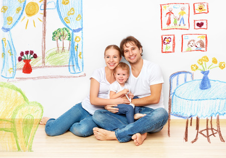Concept family: Happy young family in the new apartment dream and plan interior Foto de archivo