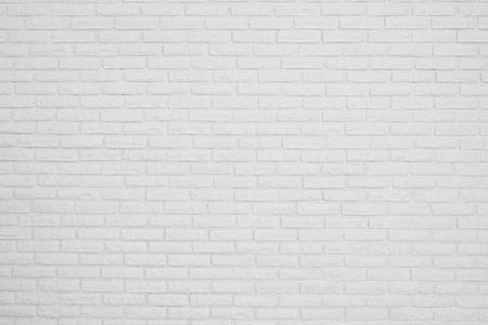 de bakstenen witte lege muur