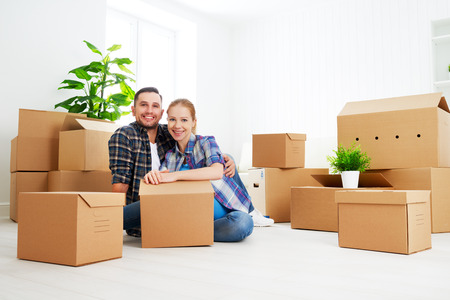 moving to a new apartment. Happy family couple and a lot of cardboard boxes. Stock Photo - 46284702