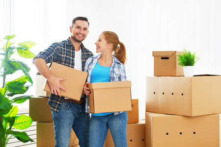 moving to a new apartment. Happy family couple and a lot of cardboard boxes.