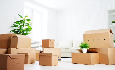 move. lots of cardboard boxes in an empty new apartment