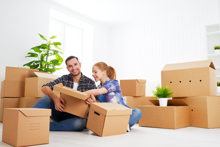 relocating: moving to a new apartment. Happy family couple and a lot of cardboard boxes.