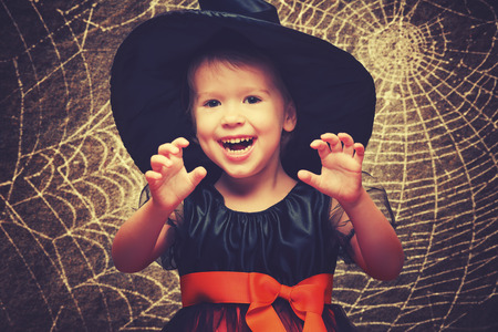 witch on broom: Halloween. funny little witch on a dark background Stock Photo