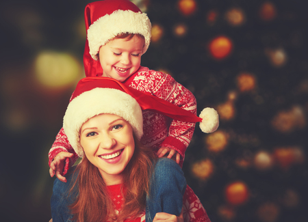 christmas fun: happy family mother and baby little child playing in the winter for the Christmas holidays Stock Photo