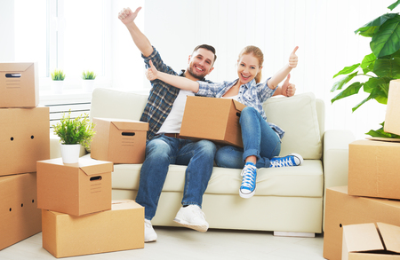 housing estate: moving to a new apartment. Happy family couple and a lot of cardboard boxes.