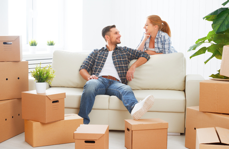 moving to a new apartment. Happy family couple and a lot of cardboard boxes. Stock fotó - 46637406