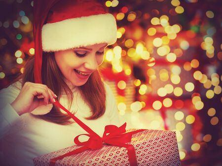 christmas woman: happy   mysterious  woman with magic gifts Christmas  night