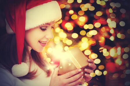 happy   mysterious  woman with magic gifts Christmas  night
