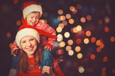 happy family mother and baby little child playing in the winter for the Christmas holidays Stock Photo