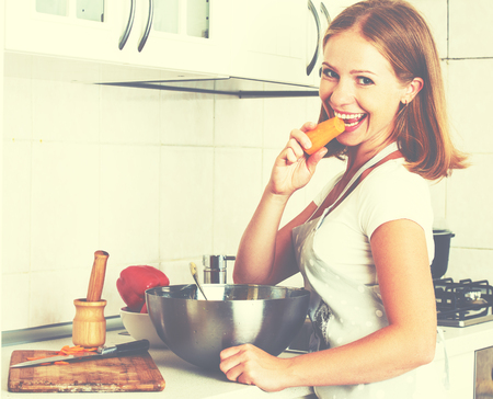 vegetable cook: young happy woman cook vegetable vegetarian salad on kitchen