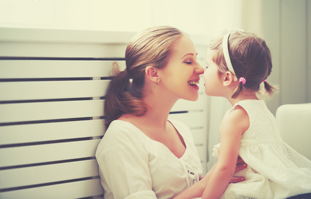 daughter mother: Happy loving family. mother and child girl playing, kissing and hugging