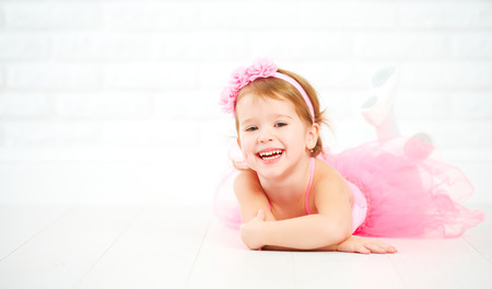little child girl dreams of becoming  ballerina in a pink tutu skirt Stock Photo
