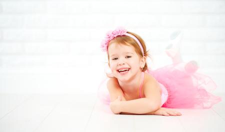 ballerina costume: little child girl dreams of becoming  ballerina in a pink tutu skirt Stock Photo