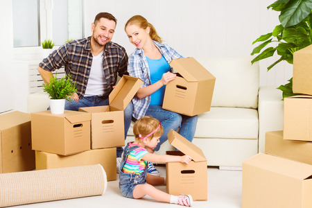 mom's house: moving to a new home. Happy family with cardboard boxes