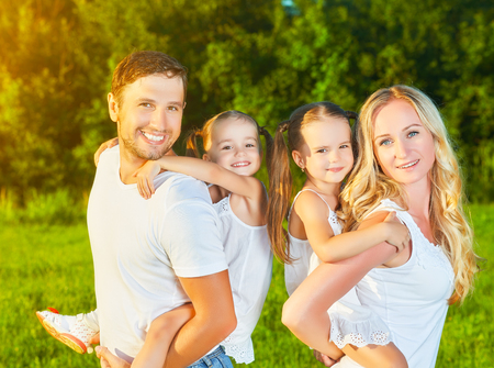 happy family nature: happy family on the nature of the summer, mother, father and children twin sisters