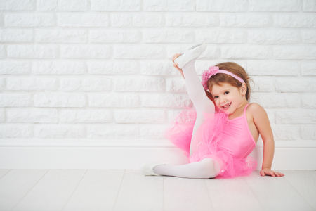 child little girl dancer ballet ballerina stretching Imagens