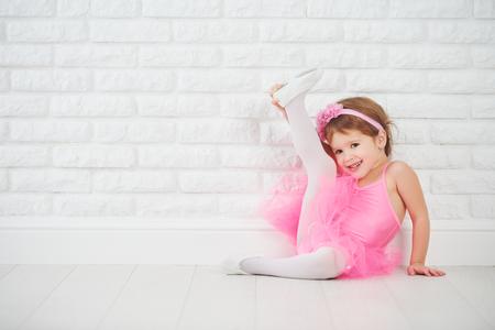 'ballet girl': child little girl dancer ballet ballerina stretching Stock Photo