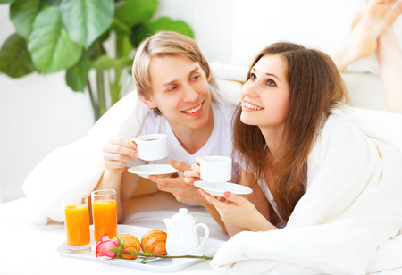 day bed: loving couple having breakfast in bed on Valentines Day