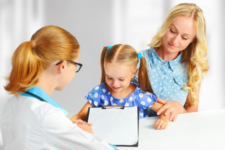 friendly: visit mother and child to the doctor pediatrician