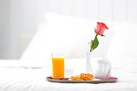 flower beds: romantic breakfast in bed and flower rose Stock Photo