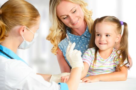 a lady doctor: Doctor a pediatrician makes child vaccinated vaccination
