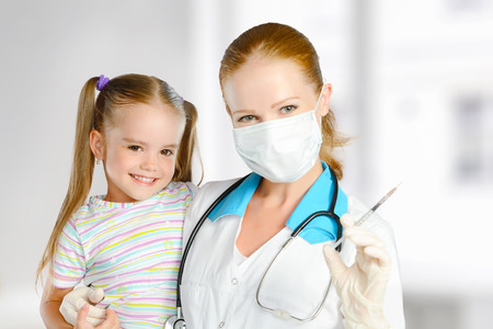 Doctor a pediatrician makes child vaccinated vaccination Stock fotó