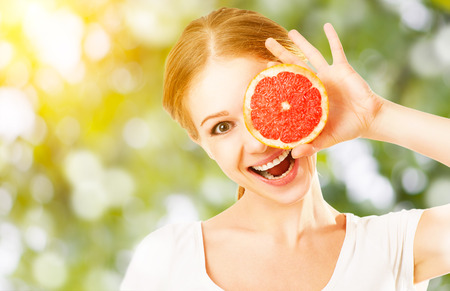 attractive female: Healthy Eating. Happy funny girl with grapefruit
