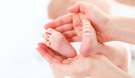 baby in hands: the feet newborn baby in arms him mother