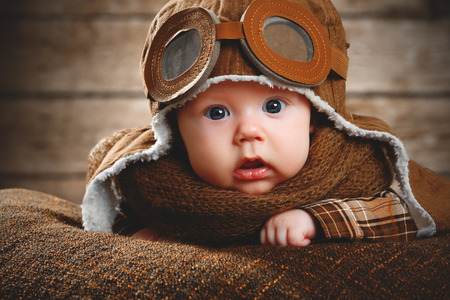 imagination: cute pilot aviator baby newborn in brown color Stock Photo