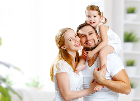 family  room: happy family mother, father,  child daughter at home