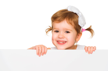 child education: concept child girl with white blank poster banner isolated Stock Photo