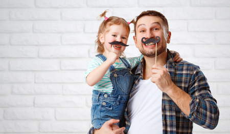 father daughter: funny family father and child daughter with a mustache