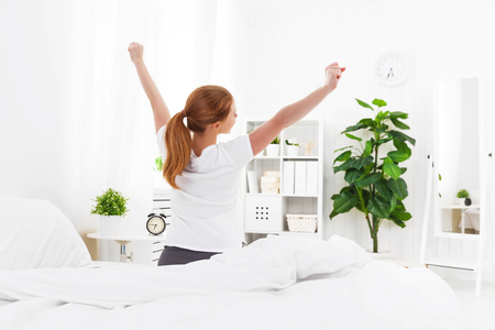 morning awakening of a young woman in bed