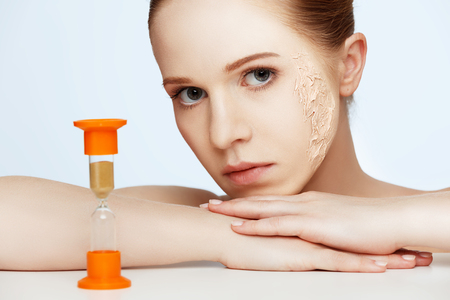 aging woman: beauty concept rejuvenation, renewal, skin care and skin problems with hourglass