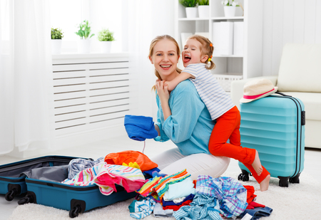 happy family tourist mother and child daughter suitcases packed for vacation Imagens