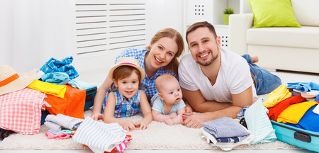 happy family mother, father and two children packed suitcases for the trip holiday travel vacation Stock Photo