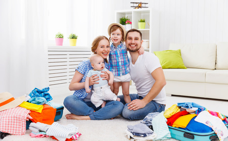 happy family mother, father and two children packed suitcases for the trip holiday travel vacation Stok Fotoğraf
