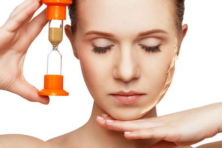 rejuvenation: beauty concept rejuvenation, renewal, skin care and skin problems with hourglass