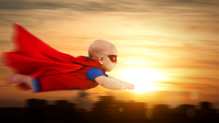 toddler little baby superman superhero with a red cape flying through sunset sky above the city Stok Fotoğraf