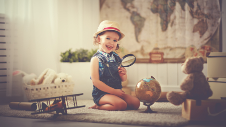 world globe map: Concept travel. child girl at home dreaming of travel and tourism, exploring the world map and globe Stock Photo