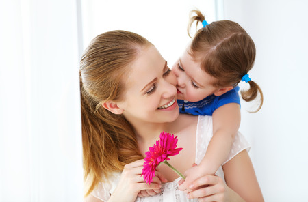 Happy loving family. mothers Day. daughter gives her mother flowers Stok Fotoğraf