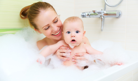 bathing in a bath with foam mother together baby son Stock Photo
